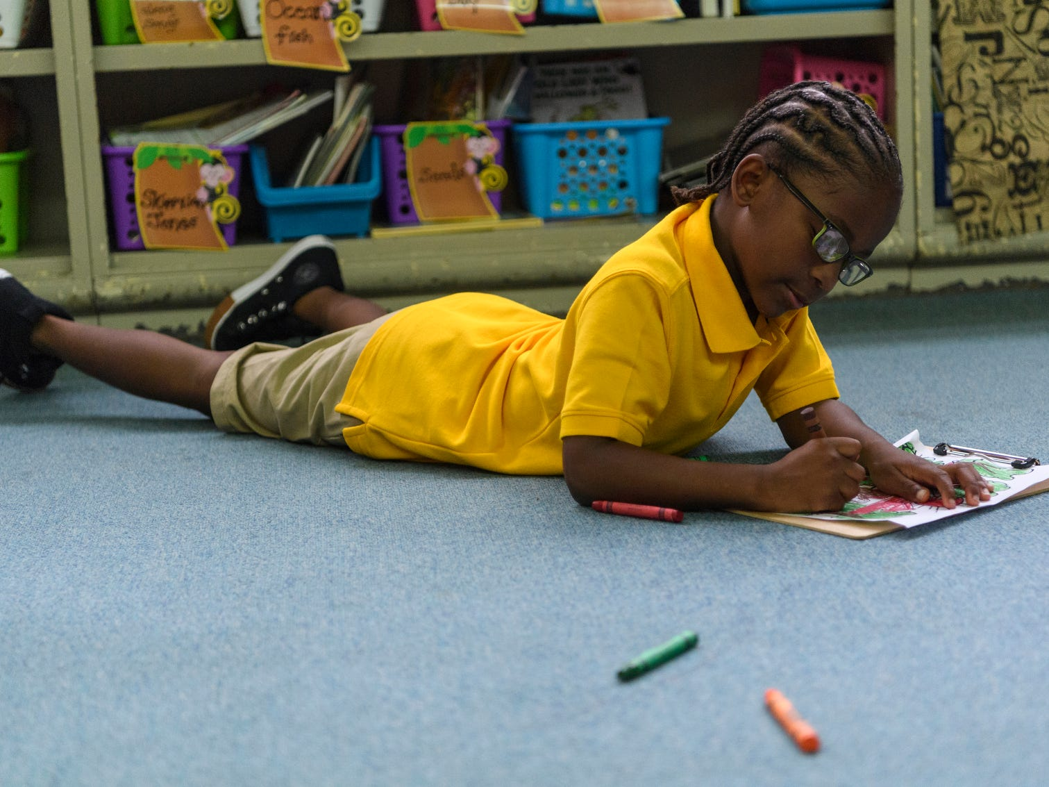 Tralaneous Thigpen makes himself comfortable inside his new kindergarten classroom on the first day of school at Dexter Elementary School in Evansville, Ind., Wednesday, Aug. 8, 2018.