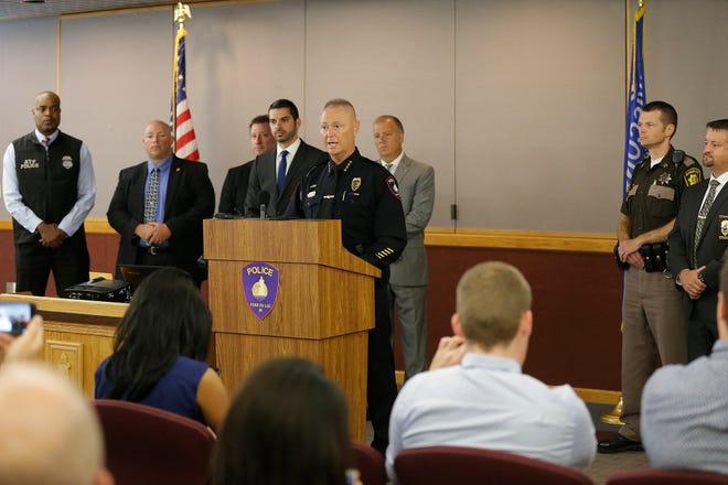 City of Fond du Lac Police Chief William Lamb addresses media Thursday, August 9, 2018 at the City of Fond du Lac Police Department regarding a large- scale cocaine ring that was broken up with 16 arrests and over 100 pounds of cocaine delivered. Lamb is surrounded by other officials  involved in the investigation. From left are: Joel Lee, assistant special agent in charge, United States Department of Justice - Bureau of Alcohol, Tobacco and Firearms (ATF); Brian Liethen, special agent in charge, Wisconsin Department of Justice – Division of Criminal Investigation & Unit Commander of the Lake Winnebago Area MEG – Drug Unit; Mike Sasse, special agent in charge (Appleton Field Office), Wisconsin Department of Justice – Division of Criminal Investigation; Fond du Lac County District Attorney Eric Toney, Lamb,  Wisconsin Attorney General Brad Schimel, Ryan Waldschmidt, Captain, Fond du Lac County Sheriff's Office; and Scott Krause, Detective, City of Fond du Lac Police Department. Doug Raflik/USA TODAY NETWORK-Wisconsin