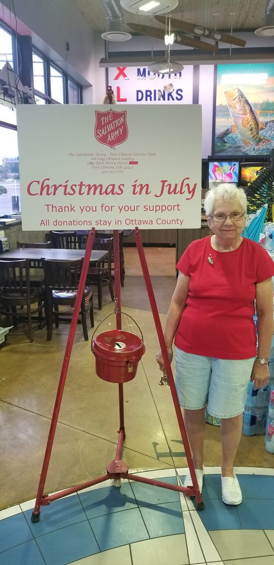 Ann Colston rings a bell for Christmas in July.