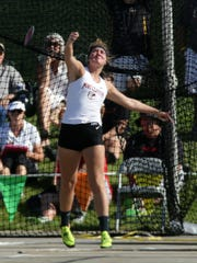 Port Clinton's Rachel Simpson, competing in the discus at state, continues her career at Ohio University.