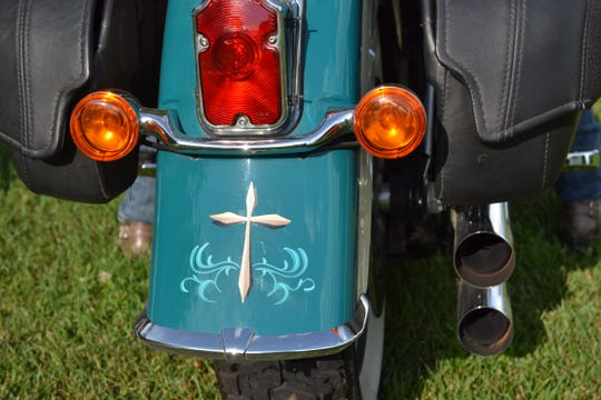 A cross adorns the rear fender of Cindi's Harley. Cindi and Randy have found Christian fellowship and the opportunity to share their faith through Heaven on Wheels, the Fremont chapter of the national Christian Motorcyclists Association.