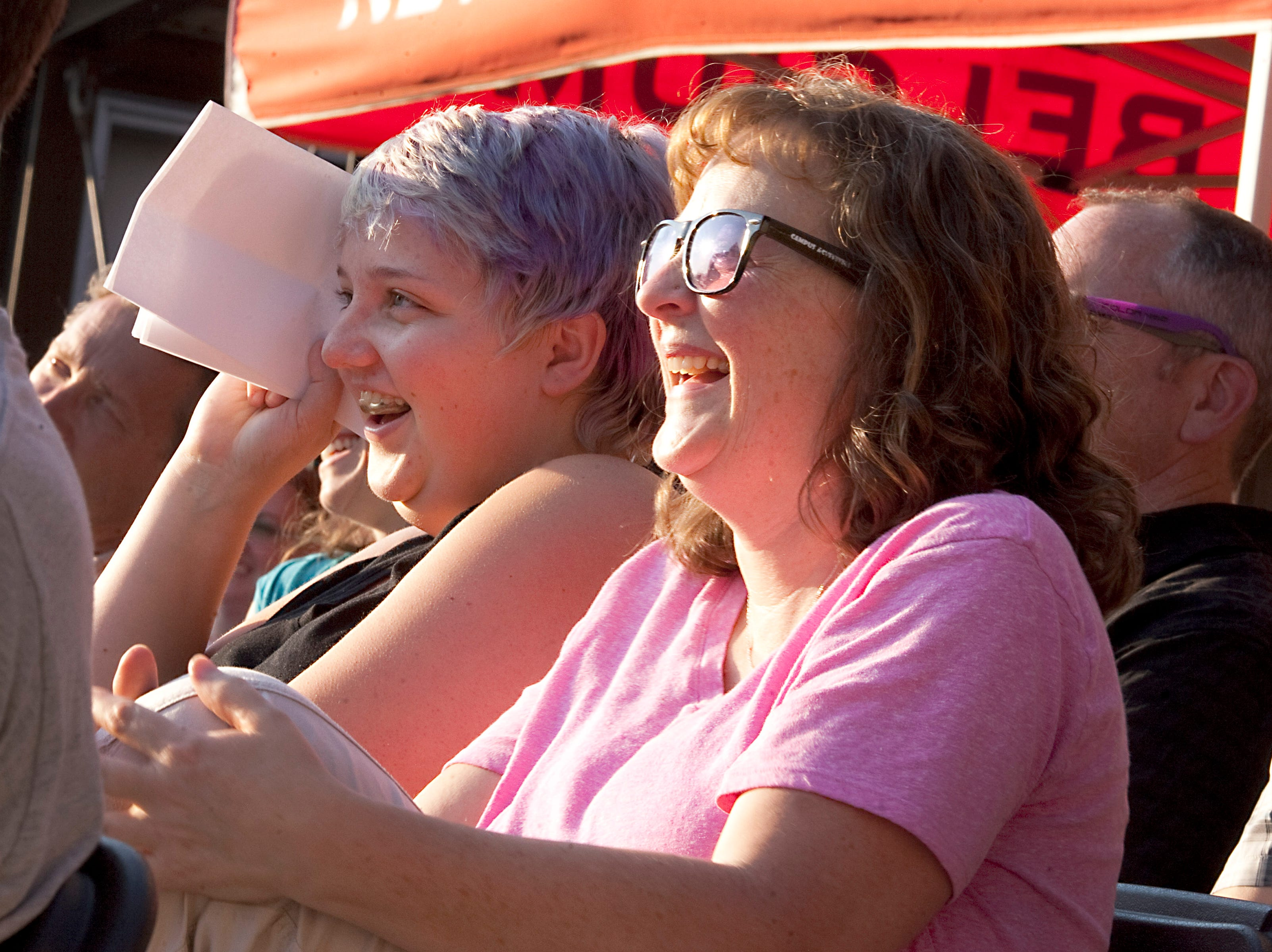 Storyteller Charles Kaine's family members, from left, daughter, Madison, and wife, Karey, laugh hysterically during Kaine's story during the Coloradoan Storytellers Project held at Wolverine Farm Letterpress & Publick House on Wednesday, Aug. 8, 2018.