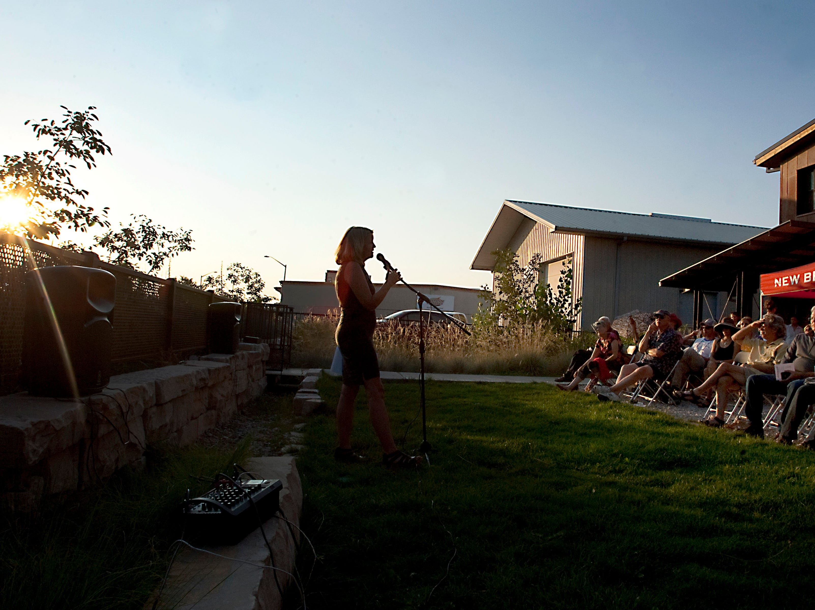 Storyteller Julie Ulstrup shares her story about her son receiving the Silver Star, during the Coloradoan Storytellers Project held at Wolverine Farm Letterpress & Publick House on Wednesday, Aug. 8, 2018. The topic for this quarterly event was parenthood.