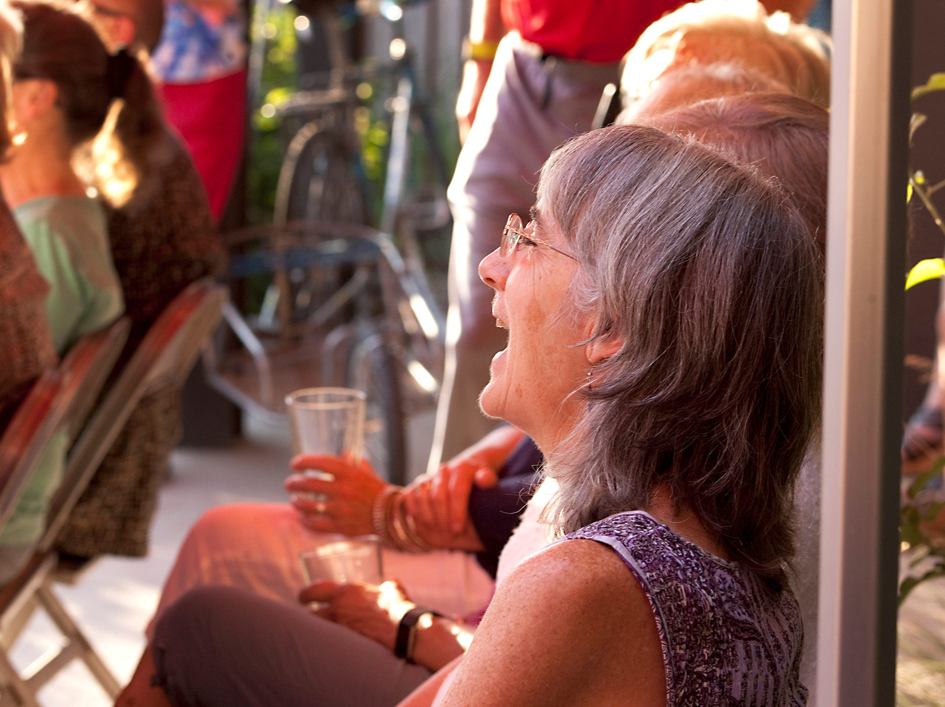 An audience member reacts to a story during the Coloradoan Storytellers Project held at Wolverine Farm Letterpress & Publick House on Wednesday, Aug. 8, 2018.