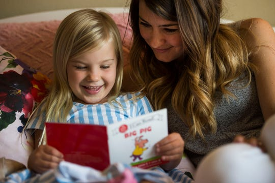 "Brittany Rossi reads ""Big Pig"" by Dr. Julie M. Wood with her five-year-old daughter Harlow on Thursday, Aug. 9, 2018, at the Rossi's home in Fort Collins, Colo. Harlow will be starting kindergarten at Zach Elementary School this Fall."