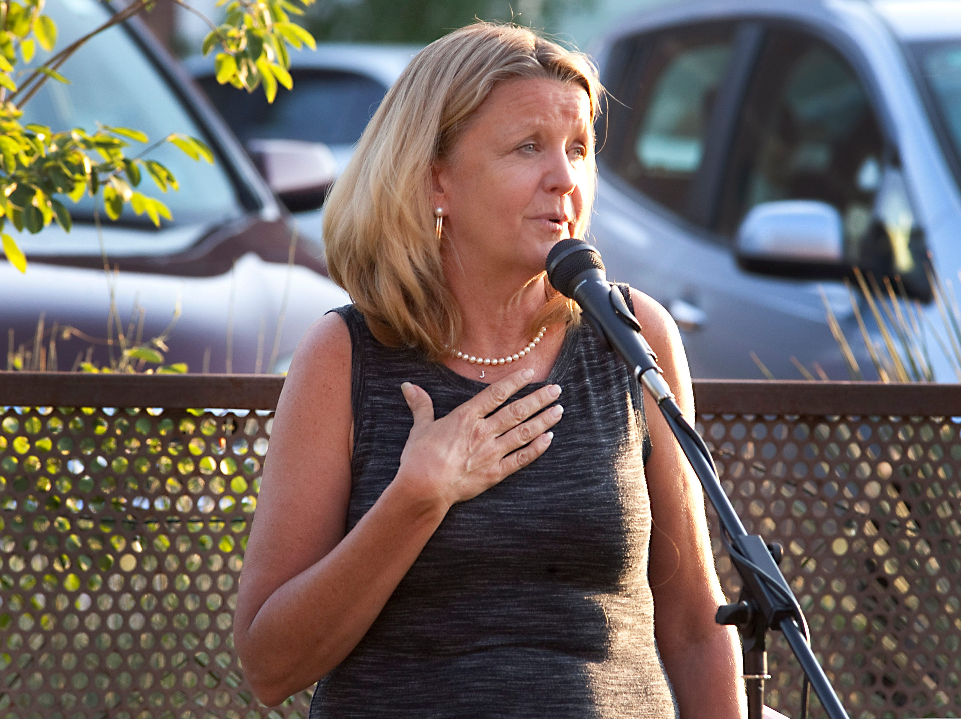 Storyteller Julie Ulstrup shares her story about her son receiving the Silver Star, during the Coloradoan Storytellers Project held at Wolverine Farm Letterpress & Publick House on Wednesday, Aug. 8, 2018.