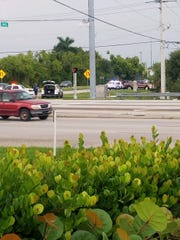 Lee County Sheriff's Office deputies gather at the scene of a car chase along Ortiz Avenue on Wednesday.
