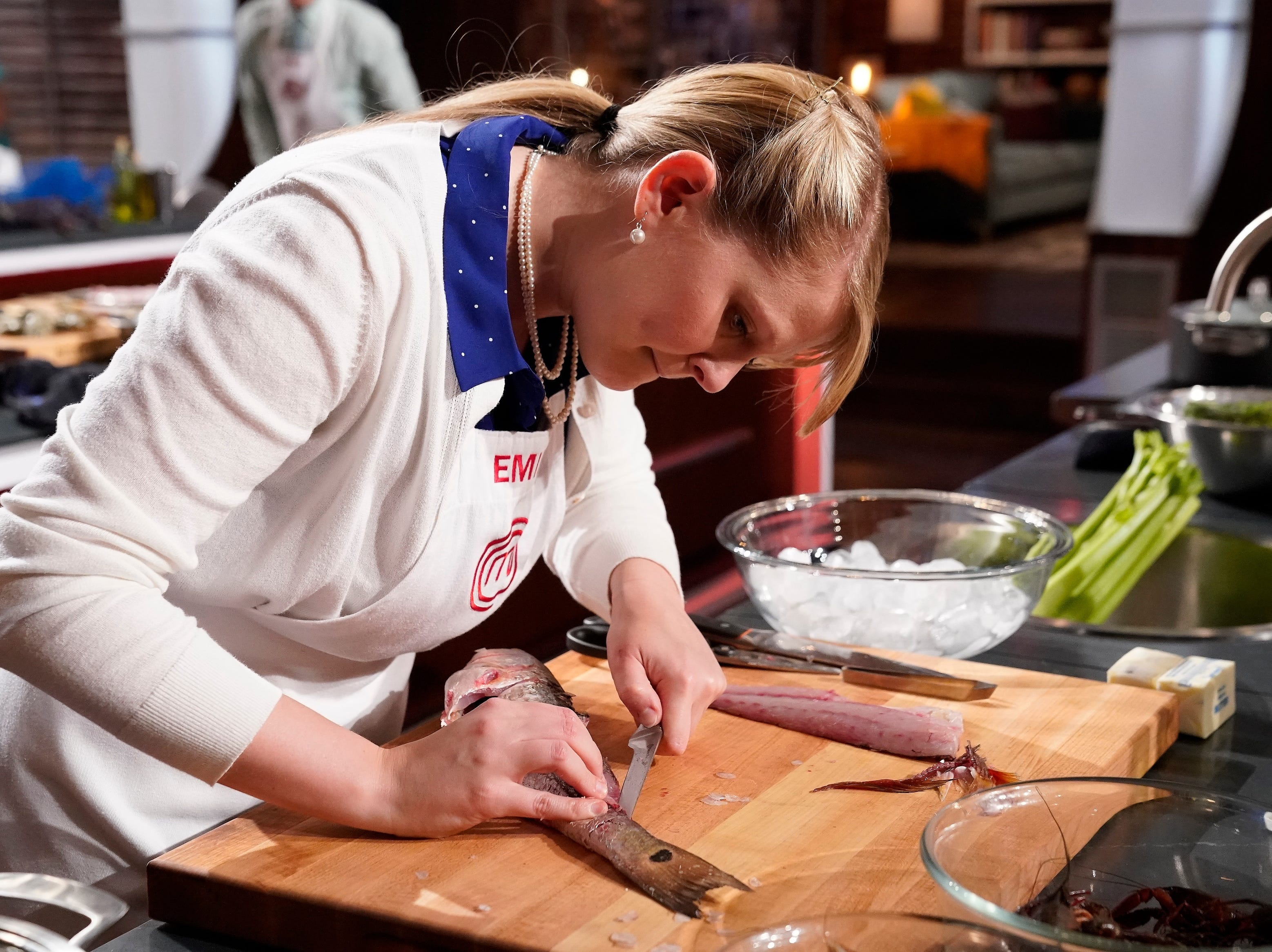 "Emily Hallock prepares fish during the ""Big Not Easy"" episode of ""MasterChef."""