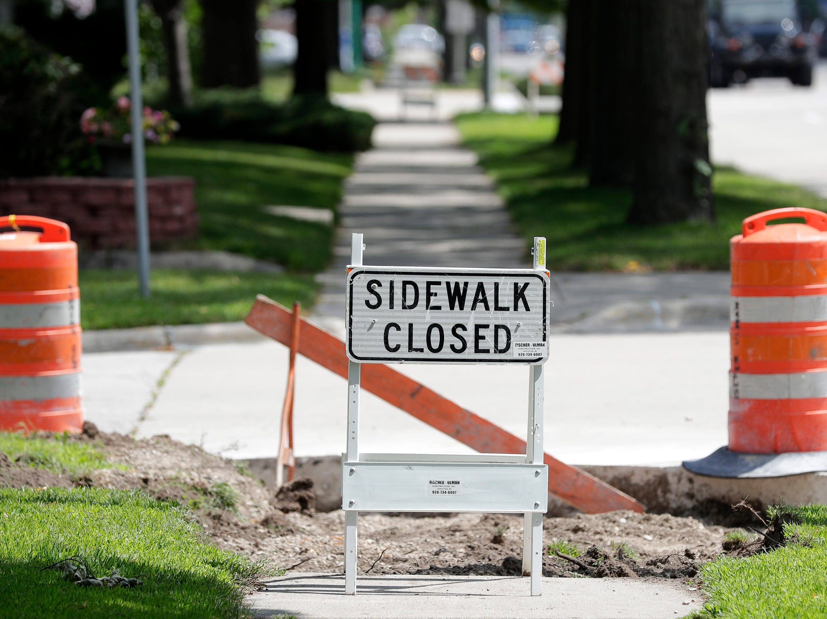 Who's responsible for bad sidewalks in Green Bay?