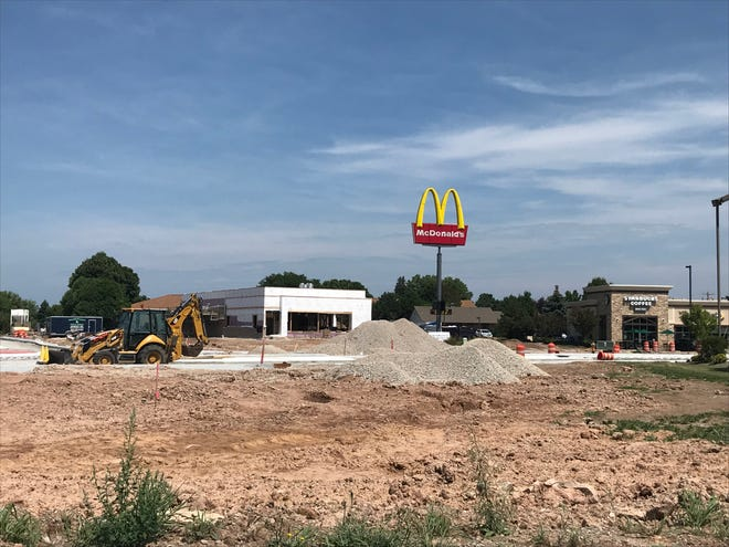 Main Avenue will be closed into September after roundabout construction fell behind schedule. The white building in the background is the new McDonald's being built.