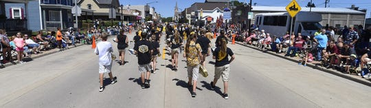 The Algoma High School Marching Band marches through downtown Algoma during last year's Shanty Days parade.