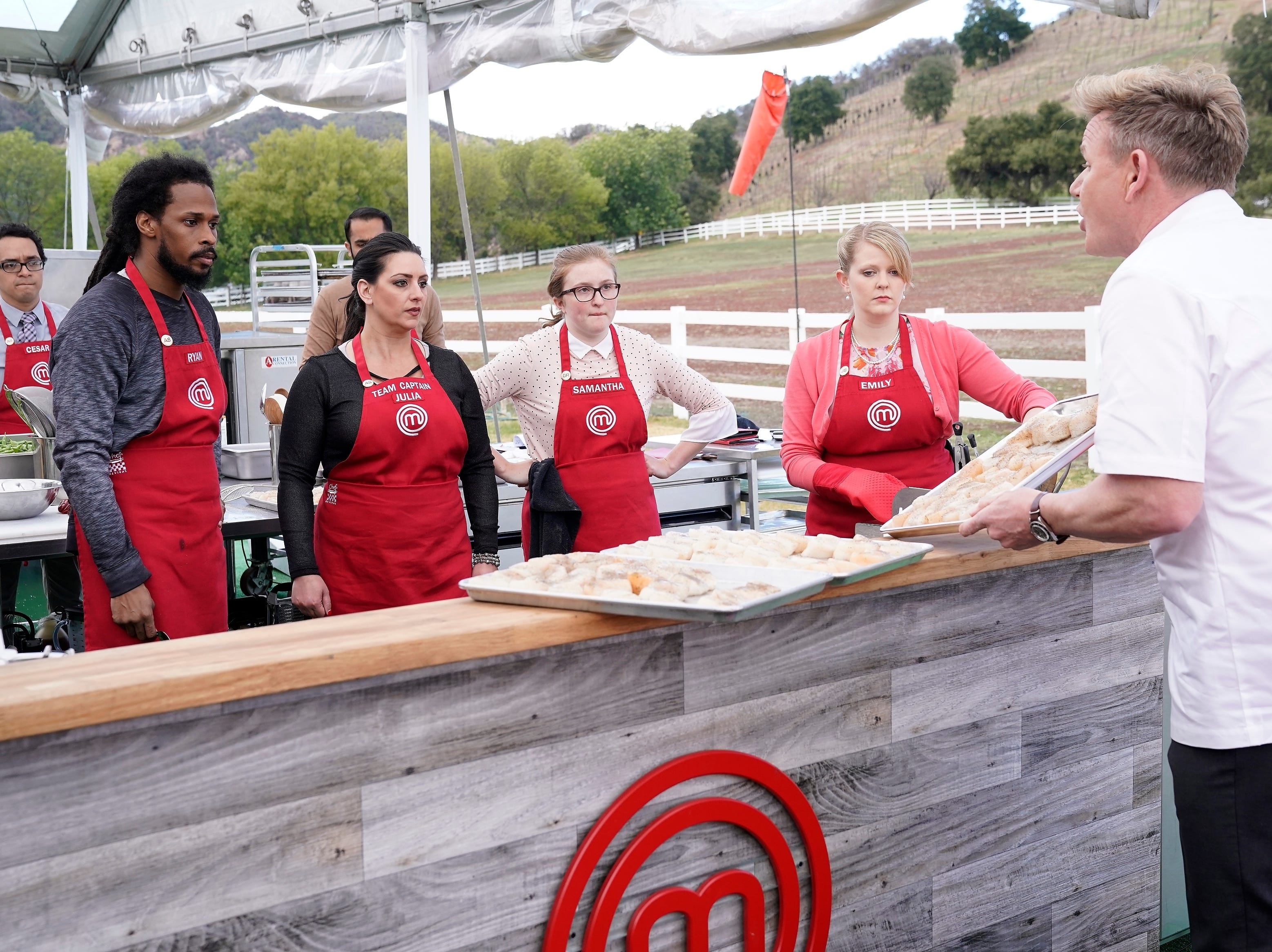 "Contestants (from left) Ryan Cortez, Julia Danno, Samantha Daily and Emily Hallock get an ear full from judge Gordon Ramsay in the ""A Gordon Ramsay Wedding"" episode of ""MasterChef."""
