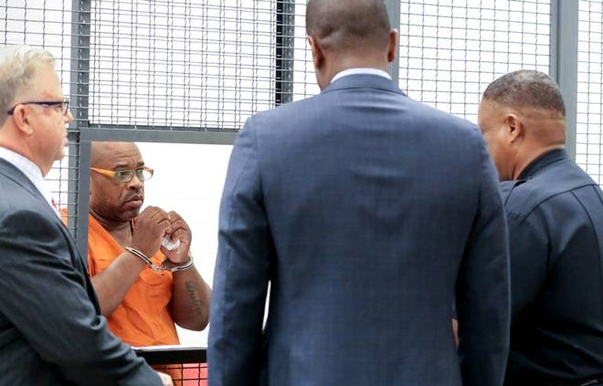 Randy Scott talks with his attorneys, Bakari Sellers, center, and Pete Strom, left, during a bond hearing at Alvin.S. Glenn Detention Center. Scott was charged after finding what appears to be drugs in his home.