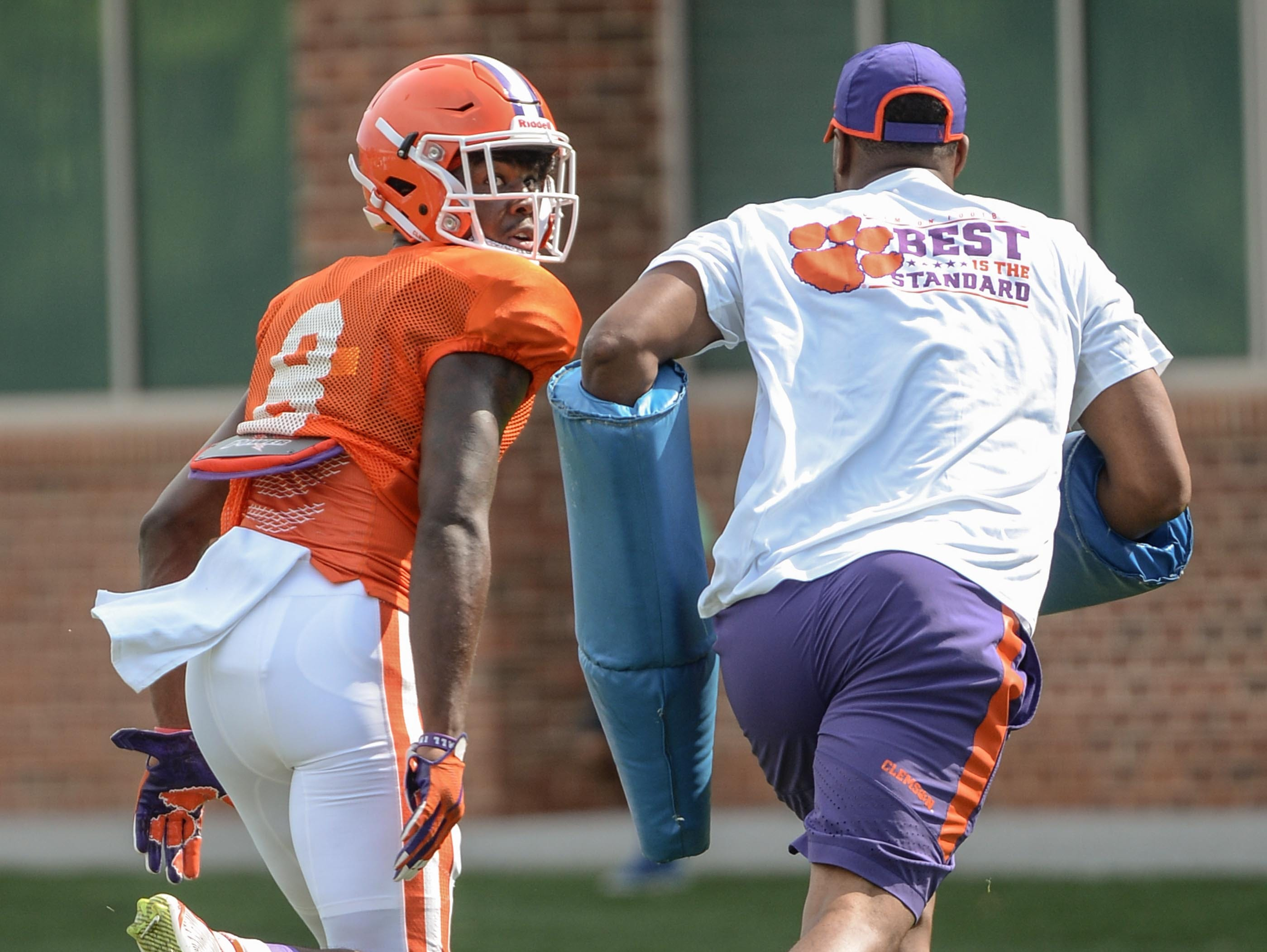 Clemson wide receiver Justyn Ross (8) is followed by receiver coach Xavier Dye, a former Clemson wide receiver, during fall practice in Clemson on Wednesday.