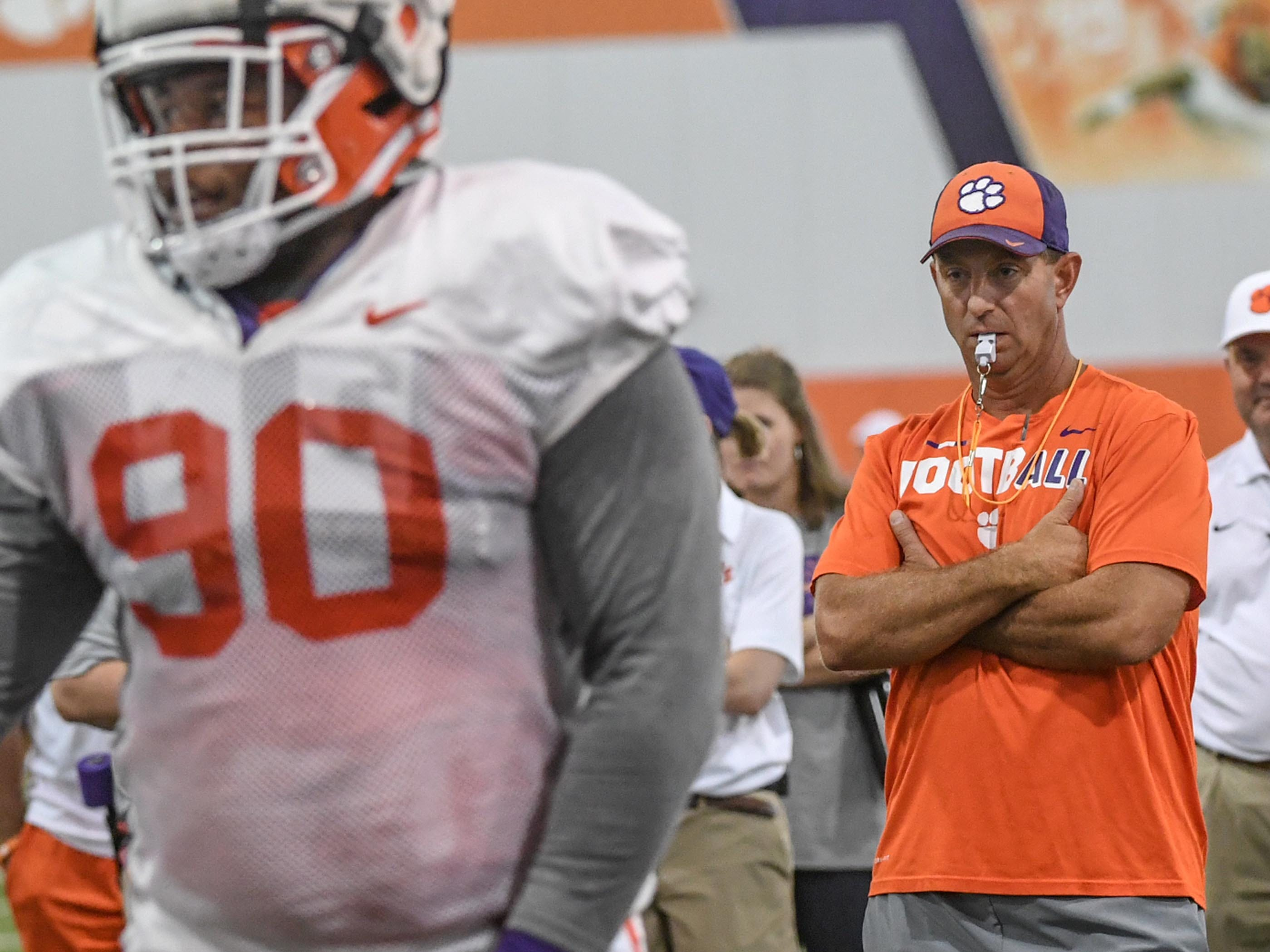 Clemson head coach Dabo Swinney, right, watches defensive lineman Dexter Lawrence (90) during fall practice in Clemson on Wednesday.