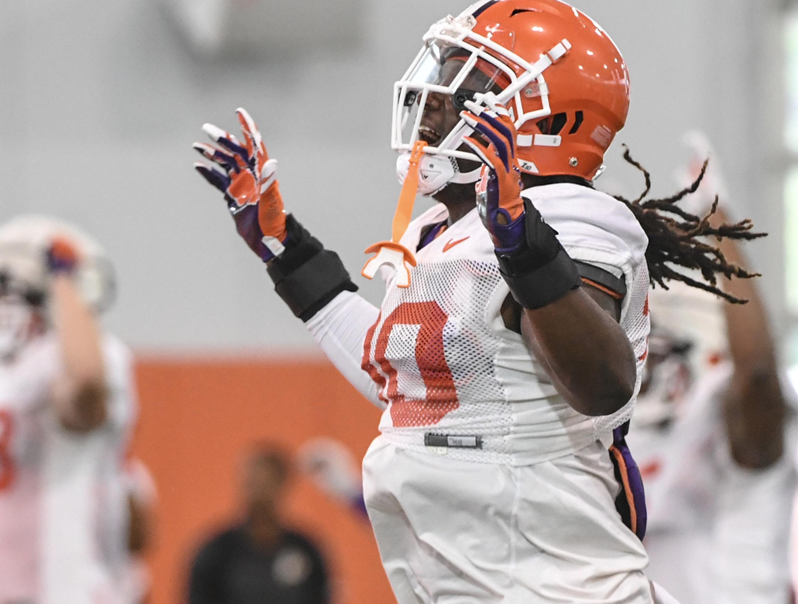 Clemson linebacker Jalen Williams (30) stretches during fall practice in Clemson on Wednesday.