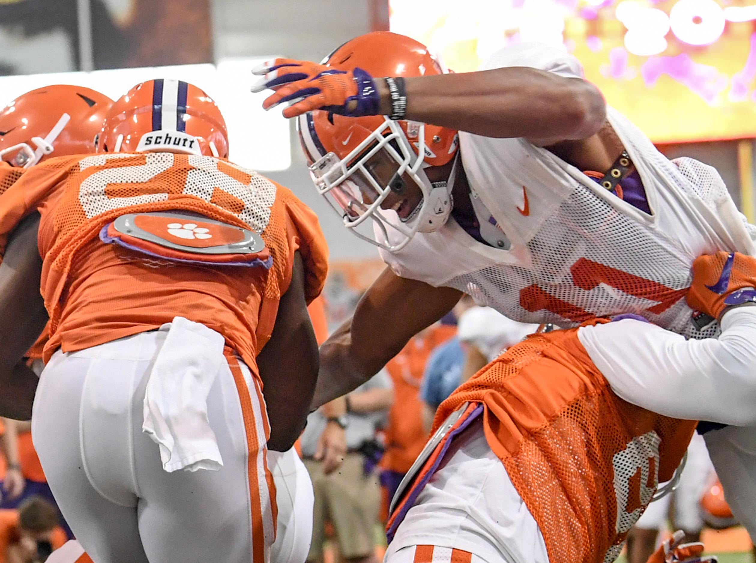 Clemson safety Isaiah Simmons (11), right, reaches out to tackle running back Tavien Feaster (28) during fall practice in Clemson on Wednesday.