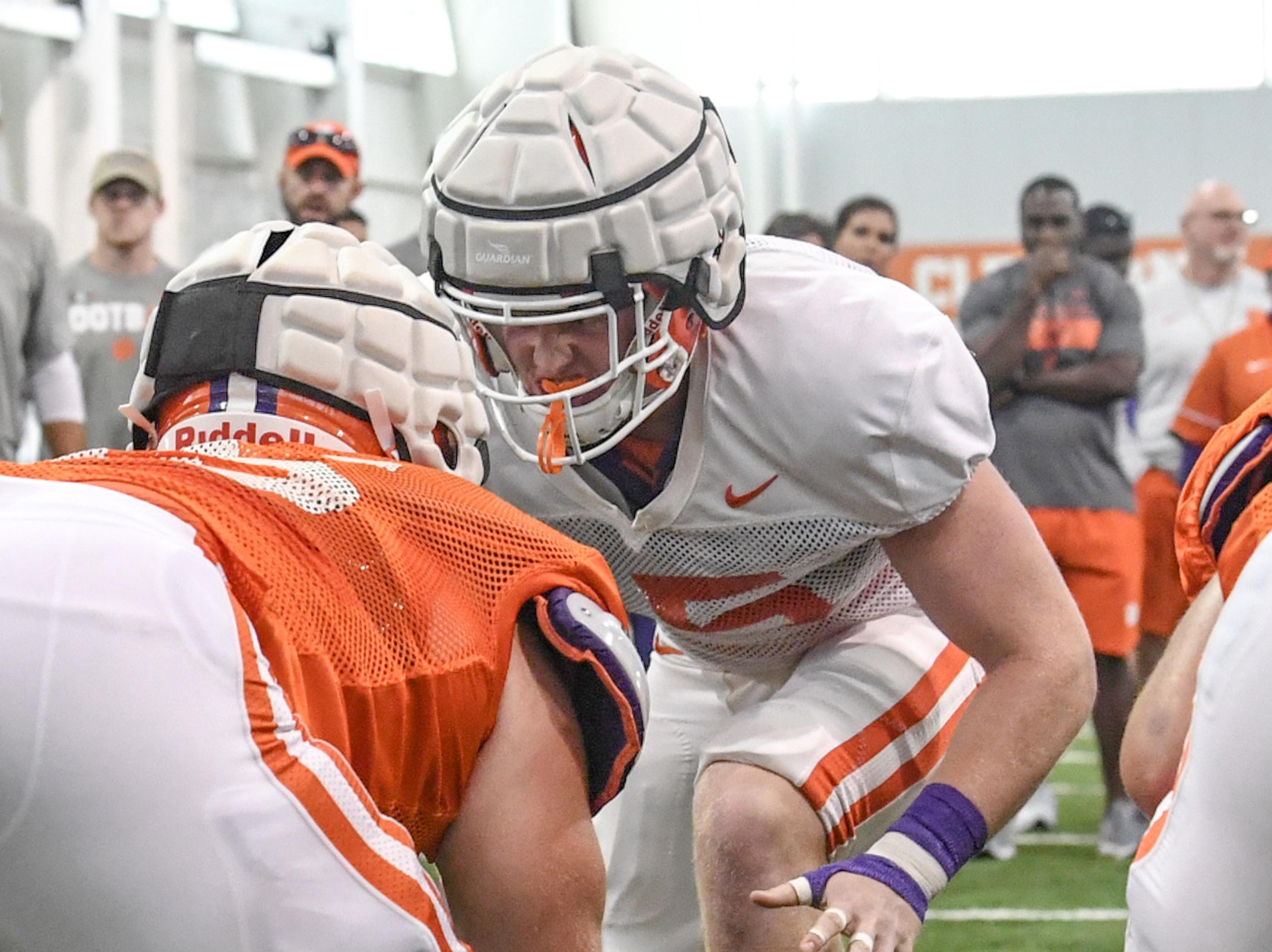 Clemson offensive lineman Matt Bockhorst (65), left, goes up against linebacker Jake Venables (15) during fall practice in Clemson on Wednesday.