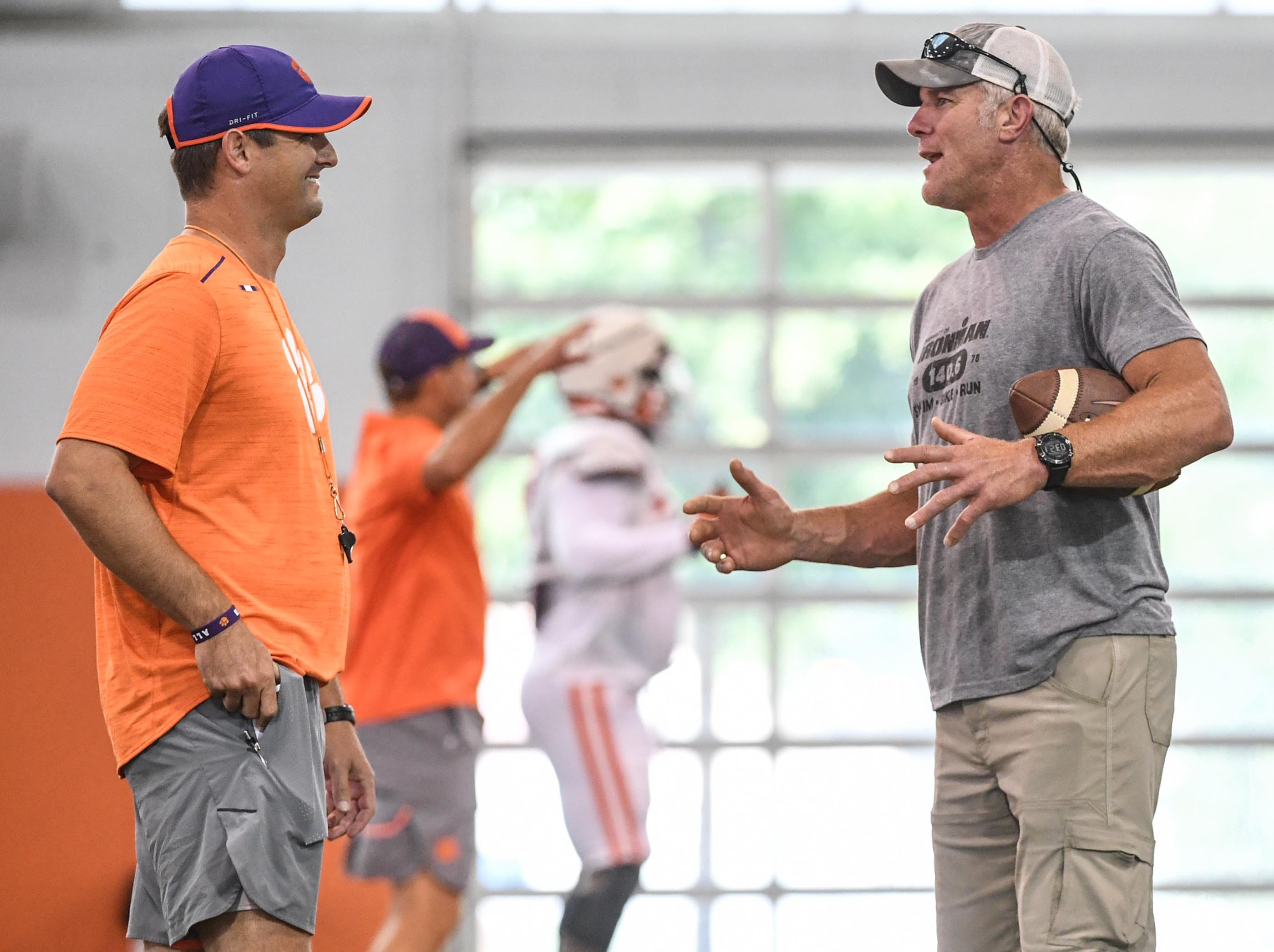 Clemson co-offensive coordinator Jeff Scott, left, and Brett Favre speak during fall practice in Clemson on Wednesday.