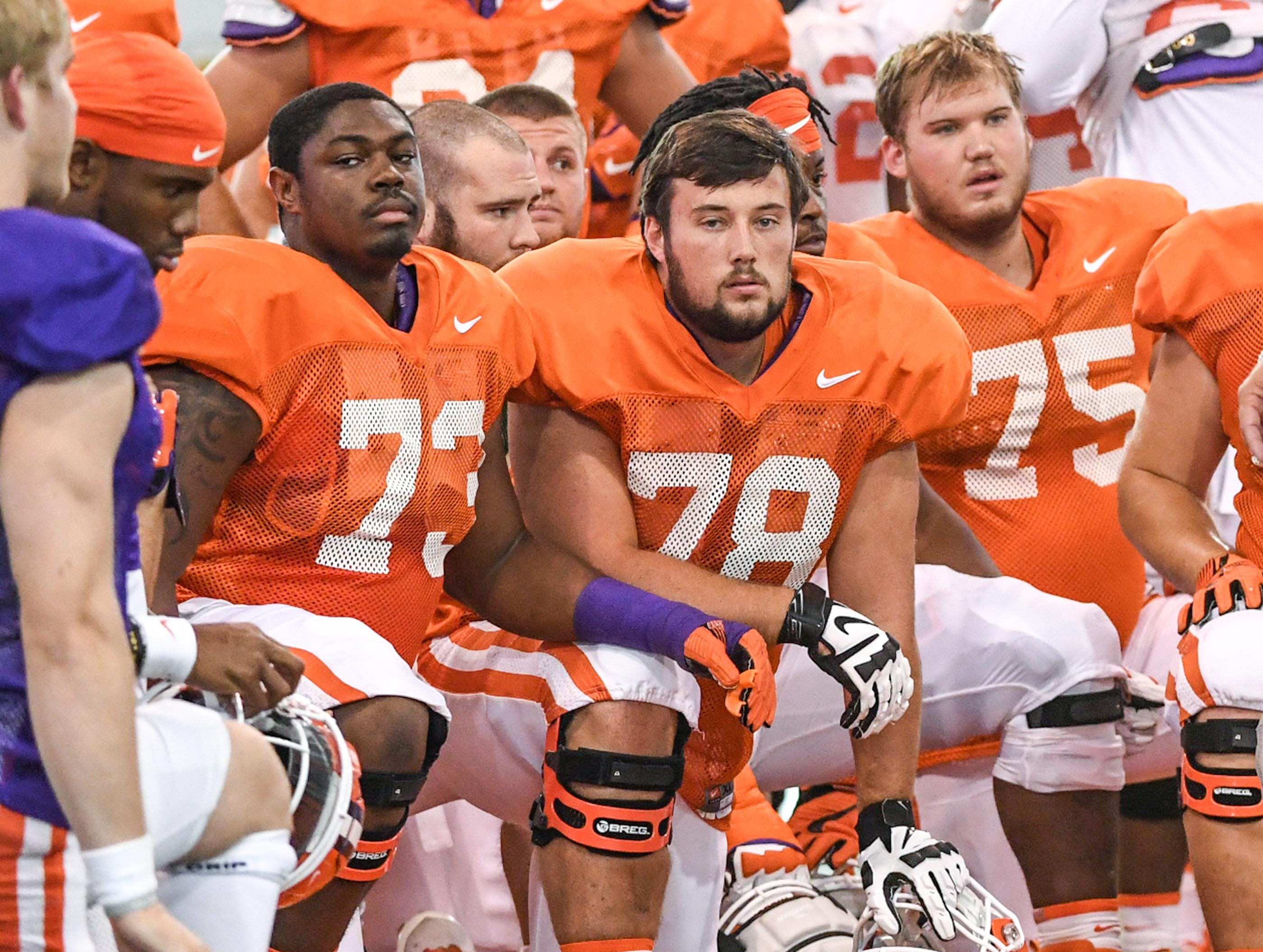 Offensive linemen, from left; Tremayne Anchrum (73), Chandler Reeves (78), and Mitch Hyatt (75) during fall practice in Clemson on Wednesday.