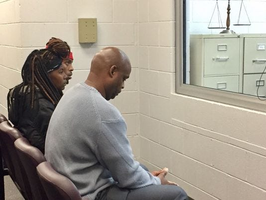 Advocate Bruce Wilson sits with Njamena Wilcox and William Patrick Henry at Travis Wagner's bond hearing.