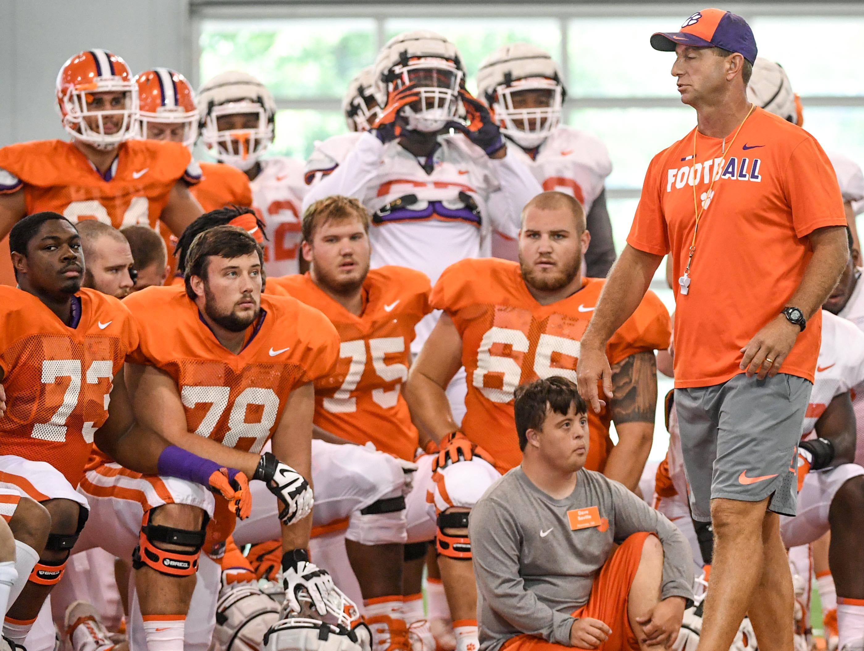 Offensive linemen, from left; Tremayne Anchrum (73), Chandler Reeves (78), Mitch Hyatt (75), and Matt Bockhorst (65) listen to head coach Dabo Swinney during fall practice in Clemson on Wednesday.