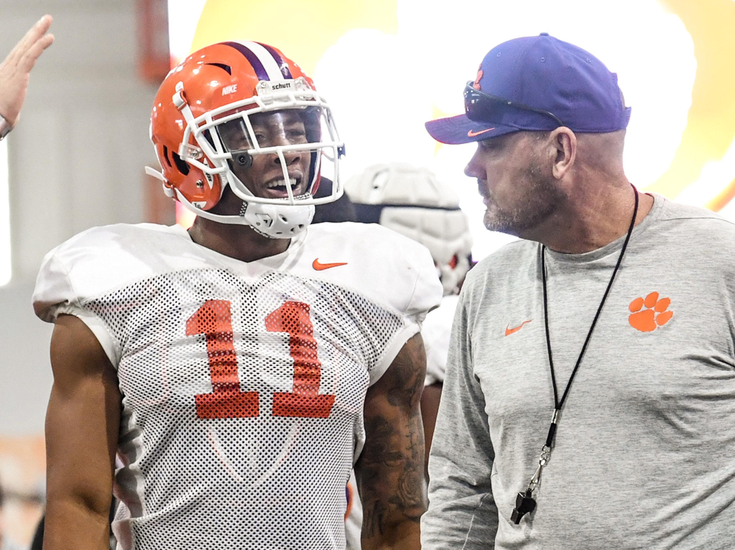 Clemson safety Isaiah Simmons (11) talks with Clemson assistant head coach coach Danny Pearman during fall practice in Clemson on Wednesday.