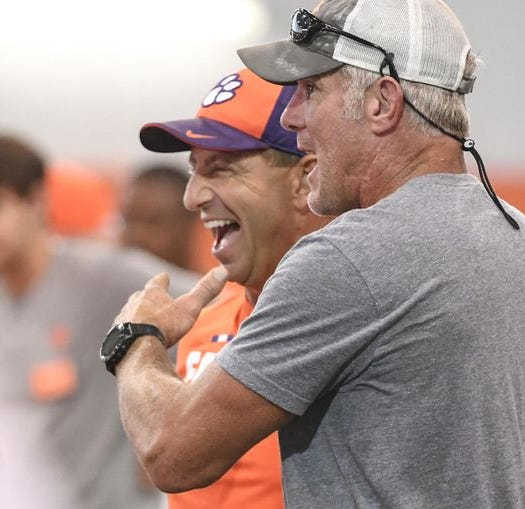 Clemson's Dabo Swinney gets his wish by catching a pass from NFL Hall of Famer Brett Favre