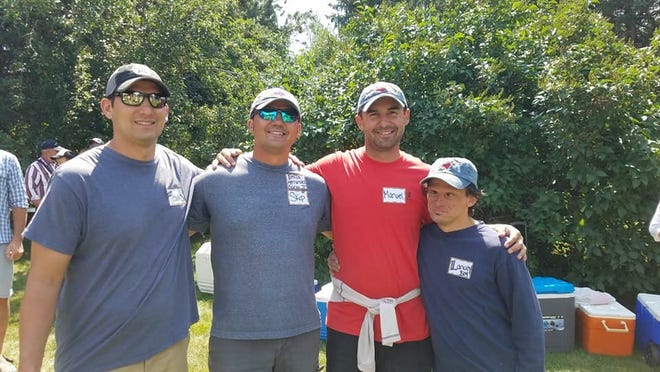 Manny Garza (second from right), pictured with brothers Travis, Skip and Lance, was named the head track and field coach at Helena High, according to the Independent Record.
