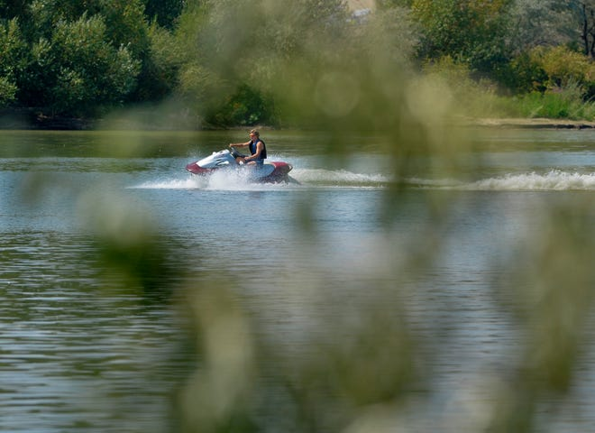 A boater on a personal watercraft enjoys zipping around Broadwater Bay.