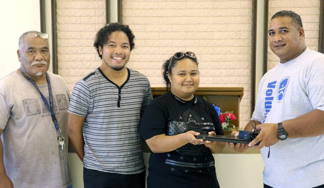 Mormon Helping Hands donated three laptops to OurYAP, a nonprofit group in Yap. From left: John G. Mangefel, Yap State Department of Youth Services; Joshua Libyan and Michelle Chugen, OurYAP; and Jim Hachigeiresh, district president of the The Church of Jesus Christ of Latter-day Saints.