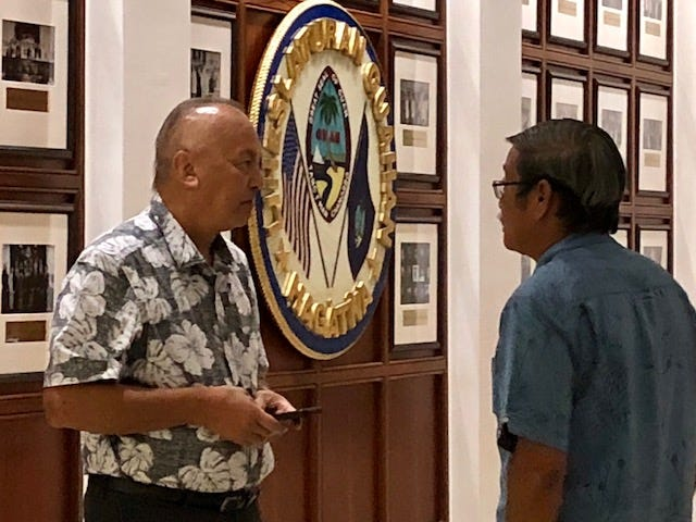 Sen. Joe San Agustin, right, tells Revenue and Taxation Director John Camacho, left, that the oversight hearing on Rev and Tax would have to be rescheduled for next week because senators were still in session at past 6 p.m. Thursday.