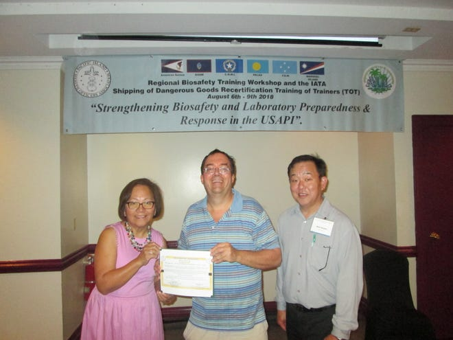 Dr. Philip Dauterman was awarded a training certificate on August 7 by Dr. Rebecca Sciulli and Dr. Mark Nagata of the Hawaii State Department of Health for training in IATA dangerous goods shipping at the Royal Orchid Hotel in Tumon.