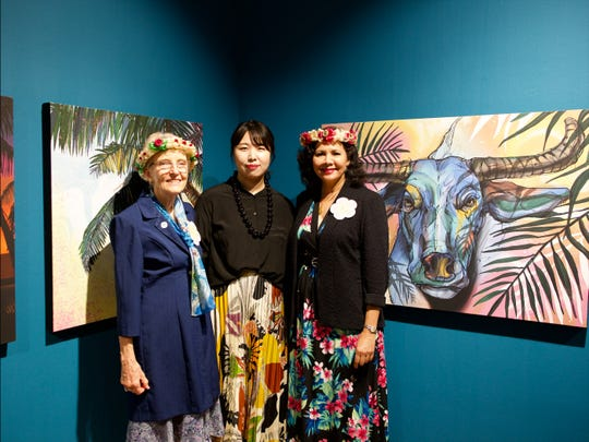 Judy Flores, left, illustrator Bang Ji Hee, center, and Pilar Laguaña, GVB's director of global marketing are shown at the Guam Eco Wave exhibition in South Korea.