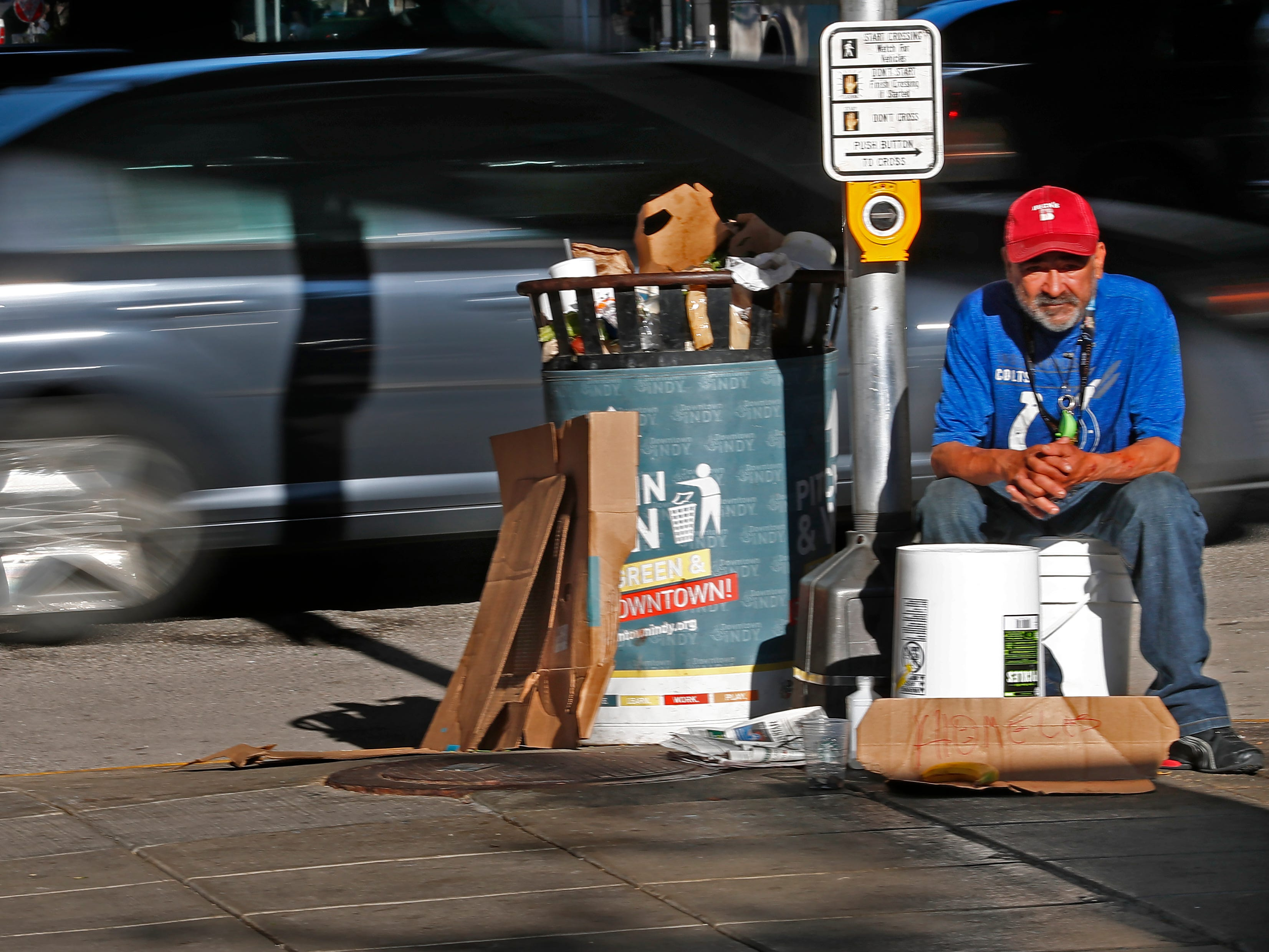 As cars speed by on Illinois St., Roberto Green, a homeless man, waits for handouts in downtown Indianapolis, Thursday, Aug. 9, 2018.  He says he is waiting for disability.  Coalition for Homelessness Intervention & Prevention (CHIP) and the city of Indianapolis have proposed a plan to end homelessness in the city by 2023.