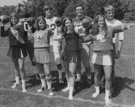 Cheerleaders Terri Sheets of Beech Grove, Suzi Zerfas of Franklin Central, Del Claeson of Lawrence Central and Warren Central's Jo Ellen Smith post with their respective football captains Nick Egan, Curt Peasa, Andy Dick and Jim Meyer prior to the Lawrence Central Jamboree in 1973.