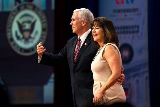 Vice President Mike Pence greets his wife, Karen, before a speech on at  National Harbor in Maryland on Feb. 22, 2018.
