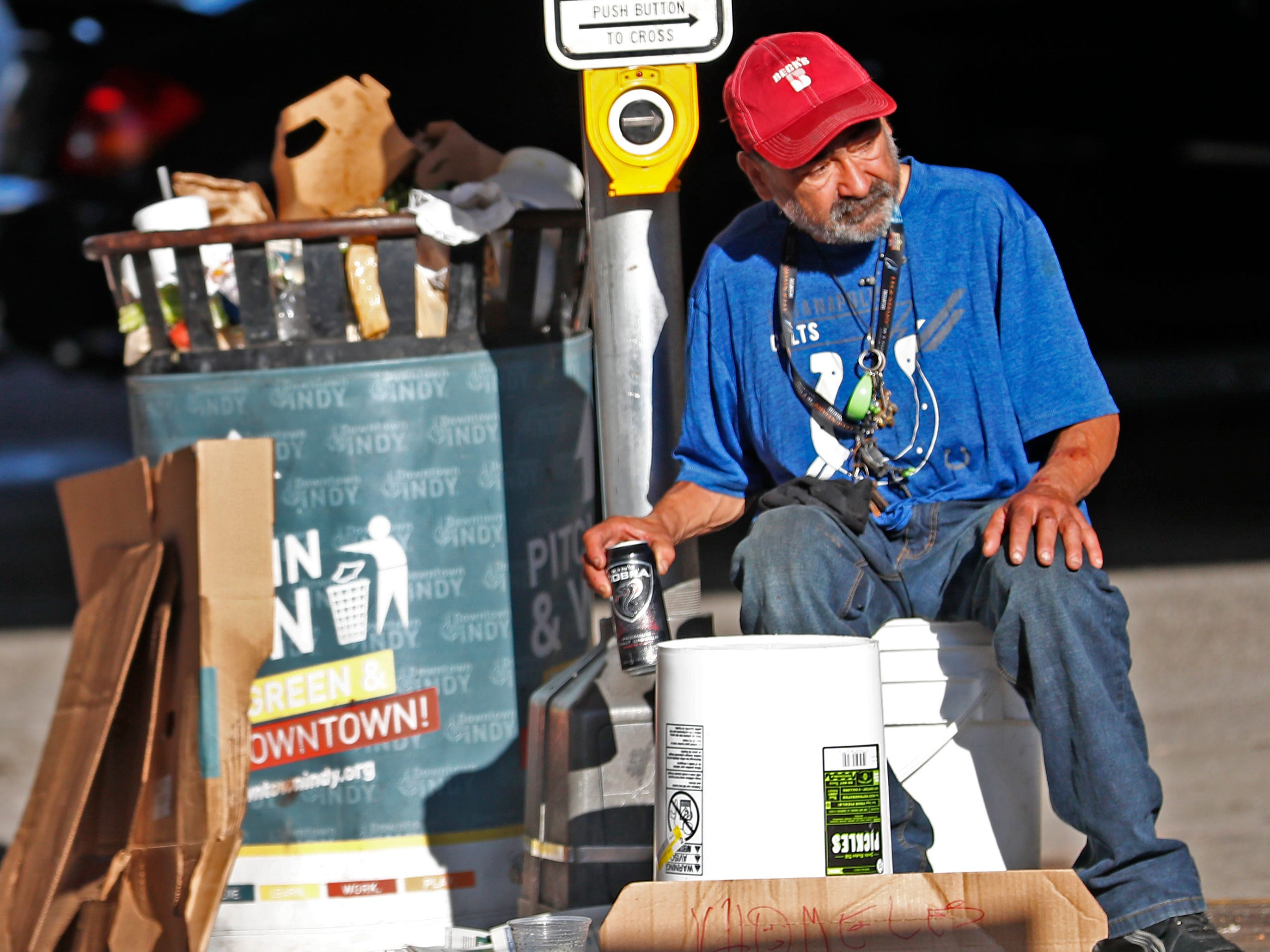 Roberto Green, a homeless man, waits for handouts in downtown Indianapolis, Thursday, Aug. 9, 2018.  He says he is waiting for disability.  Coalition for Homelessness Intervention & Prevention (CHIP) and the city of Indianapolis have proposed a plan to end homelessness in the city by 2023.