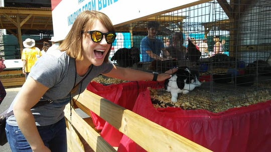 IndyStar reporter Amy Bartner pets a bunny at the 2018 Indiana State Fair.