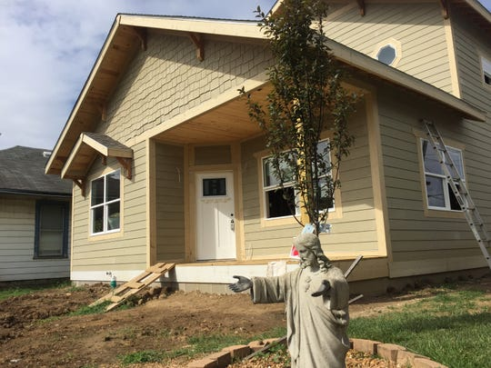 Darryl Gunyon and his siblings are building this house at 240 S. Walcott St. in Indianapolis.