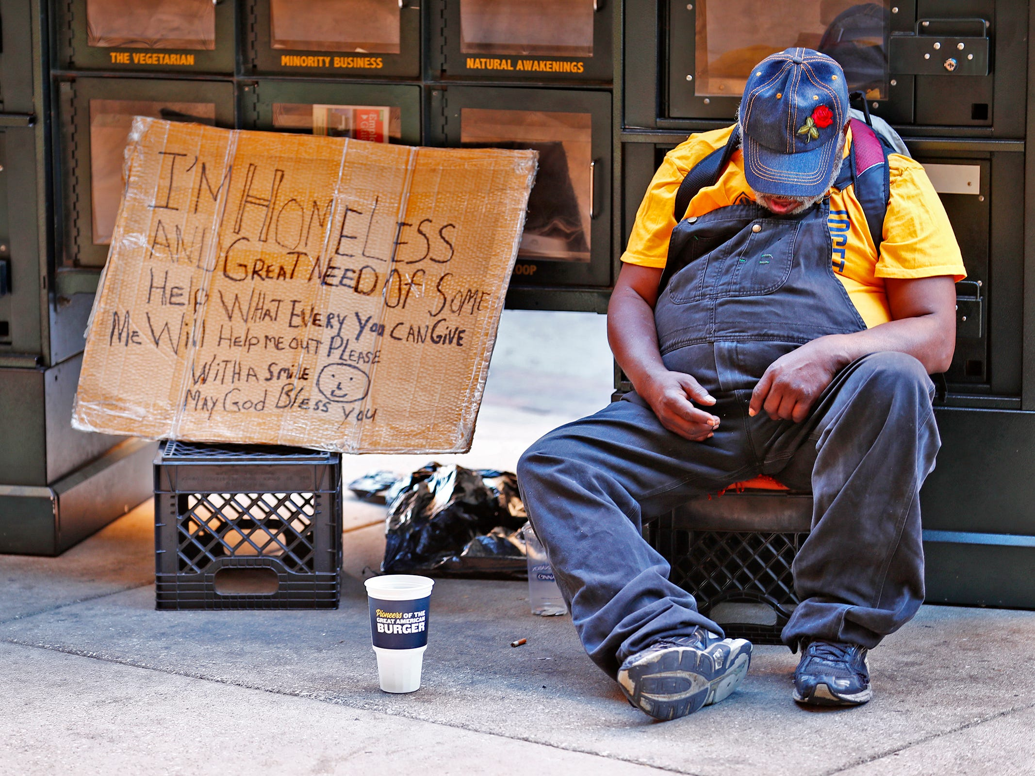 A homeless man sleeps in Illinois St. in downtown Indianapolis, Thursday, Aug. 9, 2018.  Coalition for Homelessness Intervention & Prevention (CHIP) and the city of Indianapolis have proposed a plan to end homelessness in the city by 2023.