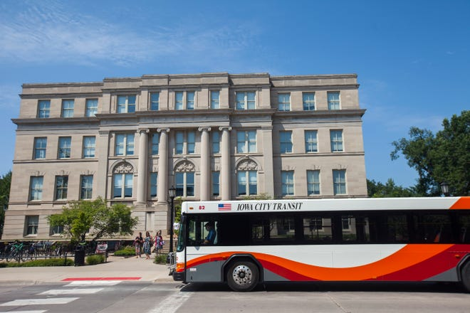 A new Iowa City Transit bus is seen at the Downtown Interchange along Washington Street on Thursday, Aug. 9, 2018, in Iowa City.