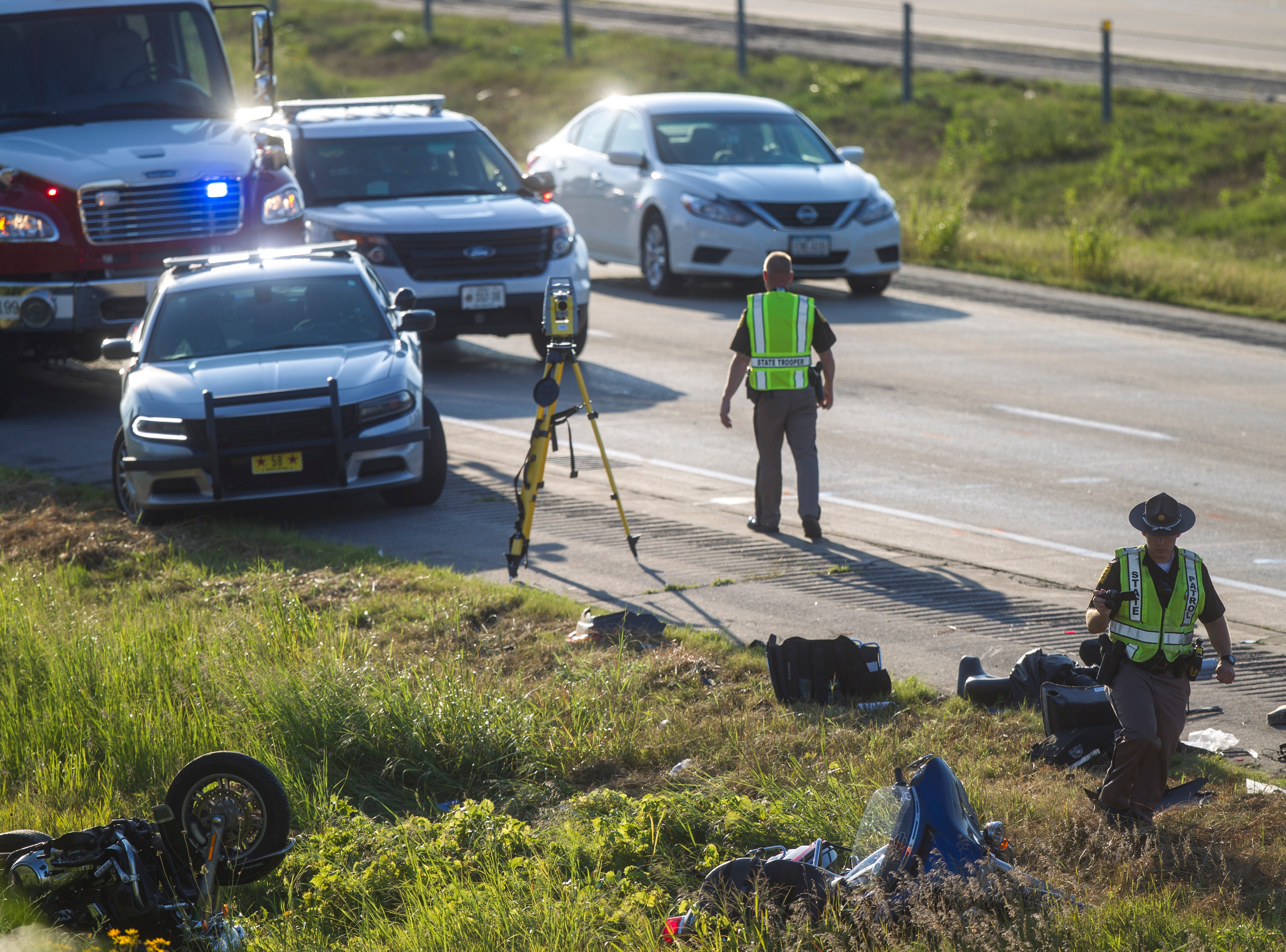 Emergency crews respond to a crash between a motorcycle and a semi on Wednesday, Aug. 8, 2018, along Interstate 80 before the X16 overpass, in Johnson County, Iowa.