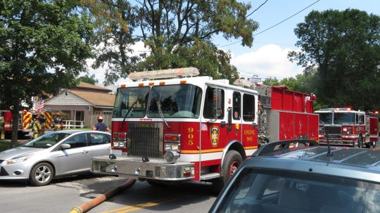 Several fire trucks were on West Court Street. as firefighters extinguished a fire at Veterinary Care of Ithaca.