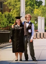 Marisha Dotson and her brother, Jack, pose for a photo the day she graduated from the University of Tennessee, May 7, 2015.