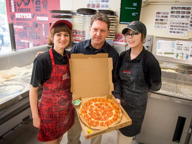 From left, Alaiah Miller, coach Chris Coffey and Sydney Hamlet are part of Team Home Run, a team out of the Knoxville Papa John's location at 1819 Lake Ave. The team will be among the six teams competing in Papa John's Global Pizza Games.