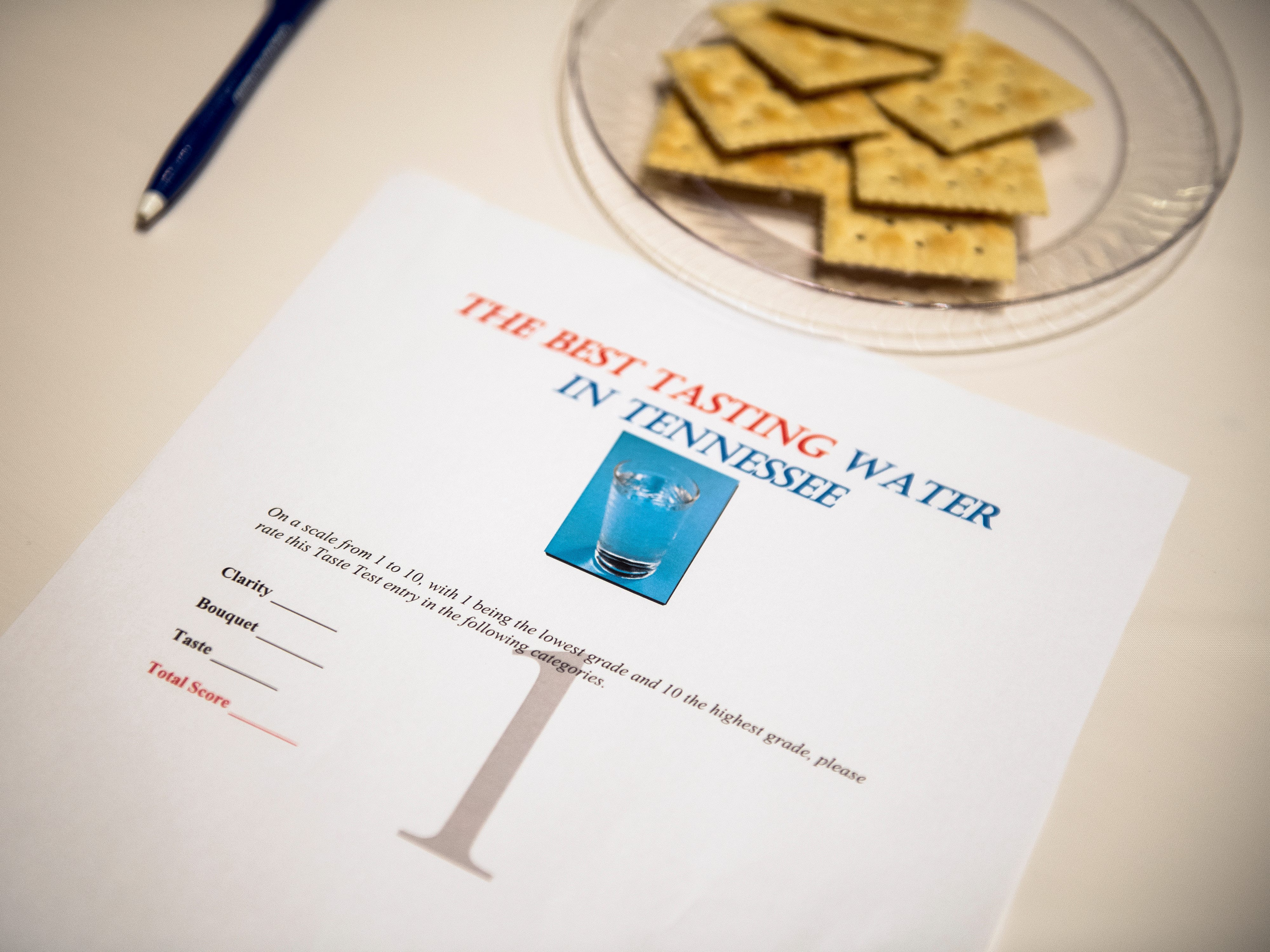 Saltine crackers and a scoring sheet wait on a table for Tennessee's Best Tasting Water Contest on Thursday, Aug. 9, 2018, at the Gatlinburg Convention Center.