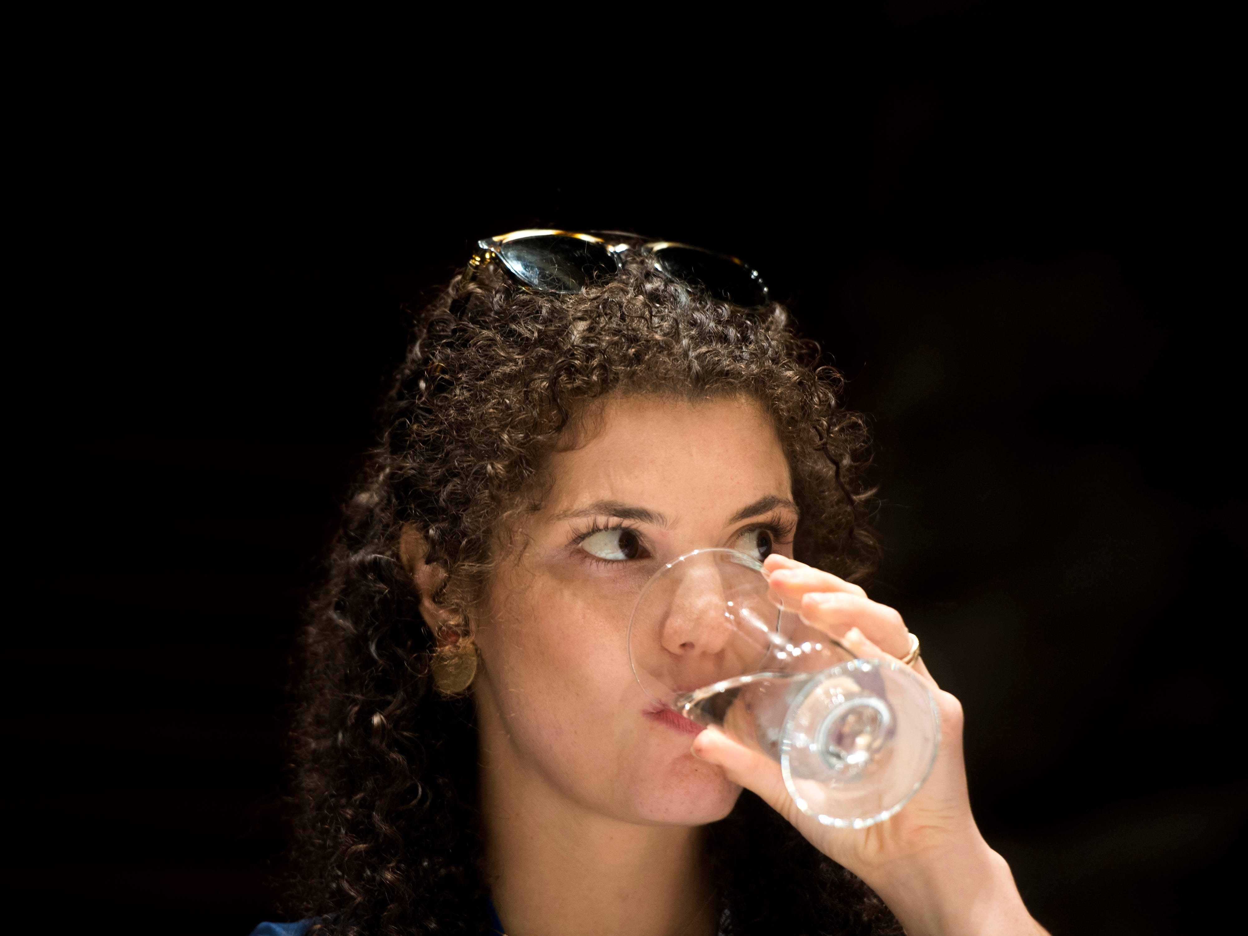 News Sentinel reporter Brittany Crocker tastes a glass of tap water during Tennessee's Best Tasting Water Contest held on Thursday, August 9, 2018, during the Tennessee Association of Utility Districts' business conference held at the Gatlinburg Convention Center.