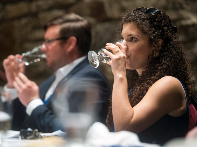 News Sentinel reporter Brittany Crocker, right, tastes a glass of tap water during Tennessee's Best Tasting Water Contest held on Thursday, August 9, 2018, during the Tennessee Association of Utility Districts' business conference held at the Gatlinburg Convention Center.