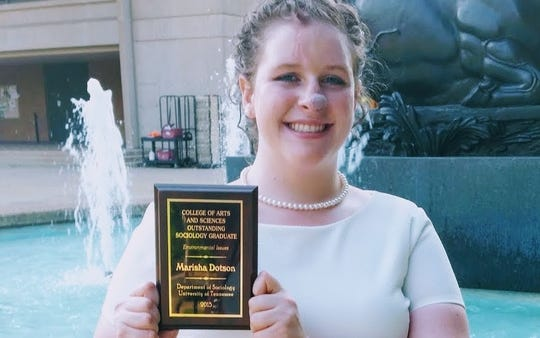 Marisha Dotson received the Outstanding Sociology Graduate award from the Department of Sociology at the University of Tennessee when she graduated on May 7, 2015.